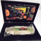JOHN DEERE KNIFE IN DISPLAY BOX....