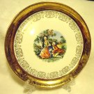 "7 1/4"" CREST O GOLD COLONIAL COUPLE PLATE/HAND PAINTED..22 K...USA"