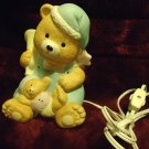 BISQUE FIGURINE NITE LITE...TEDDY BEAR IN NITE CAP & HOLDING BABY...APPROX 6""