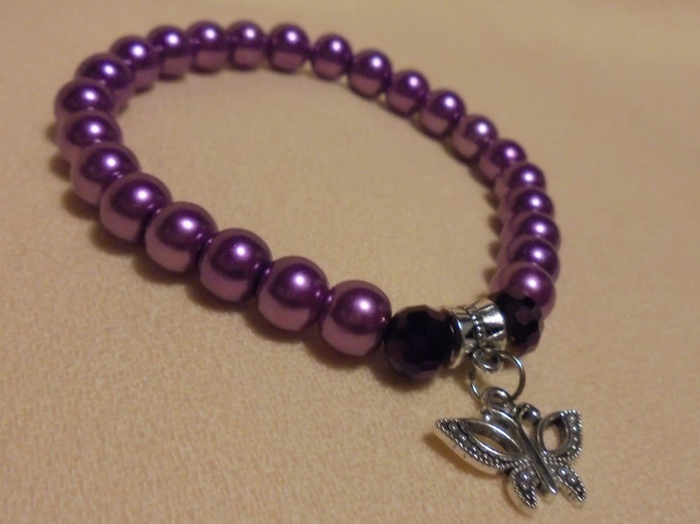 BUTTERFLY CHARM 8 MM PEARL BRACELET-EXPANDABLE....FITS ANY WRIST