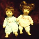 "TWO CUTE PORCELAIN DOLLS WITH CLOTH BODY....APPROX 8"" TALL...OLDER STYLE"