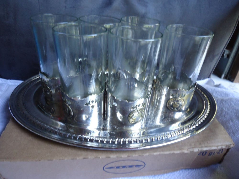 VINTAGE COLLECTABLE METALIC GLASS HOLDERS/HAS ISRAEL FLAG ON ONE/ OTHERS/NOT SUR