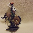 COLLECTIBLE & COLORFUL COWBOY ON BUCKING HORSE RESIN FIGURINE..APPROX 15""