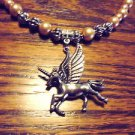 HANDCRAFTED GOLDEN BROWN BEADED NECKLACE WITH UNICORN CHARM & ACCENTS..