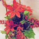 CHRISTMAS SPARKING POINSETTIA ARRANGEMENT IN SMALL WICKER CHAIR....DETAILED