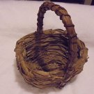 "VINTAGE 11"" TALL WOVEN BASKET WITH HANDLE...HANDMADE....UNIQUE"