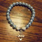 LADIES LIGHT BLUE BEADED BRACELET WITH CROSS CHARM -EXPANDABLE
