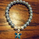 LADIES LIGHT BLUE BEADED BRACELET WITH RHINESTONE  BUTTERFLY CHARM -EXPANDABLE