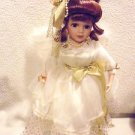 "STUNNING 17"" ANGEL PORCELAIN DOLL IN GOLD/WHITE WITH FEATHER WINGS...WITH STAND"