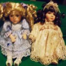 "TWO PORCELAIN DOLLS....SO PRETTY.......APPROX 10"" TO 11: TALL...NICE CLOTHES"