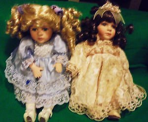 """TWO PORCELAIN DOLLS....SO PRETTY.......APPROX 10"""" TO 11: TALL...NICE CLOTHES"""