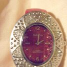 ADRINA LADIES OVAL PINK & SILVER DECORATIVE CUFF WATCH....NEW BATTERY