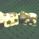 "BLACK & WHITE COWS  SALT & PEPPER SHAKERS...HARD MOLDED PLASTIC....2 3/4"" WIDEL"