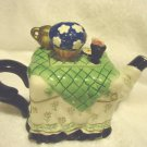 """SMALL CERAMIC TEA POT...TABLE WITH SERVING PIECES ON TOP...APPROX 6 1/2"""" WIDE"""
