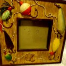 FISHERMEN FRAME BY RUSS-RESIN...APPROX 6 X 6(FRAME)..WITH RAISED FISHING TACKLE