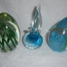 SET OF 2 NICE EGG SHAPED PAPER WEIGHTS...CLEAR WITH GREENERY & FISH IN PLANTS
