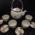 ORIENTAL TEA SET..TEAPOT & 4 COVERED CUPS...BEAUTIFUL SCENIC DECORATIONS....