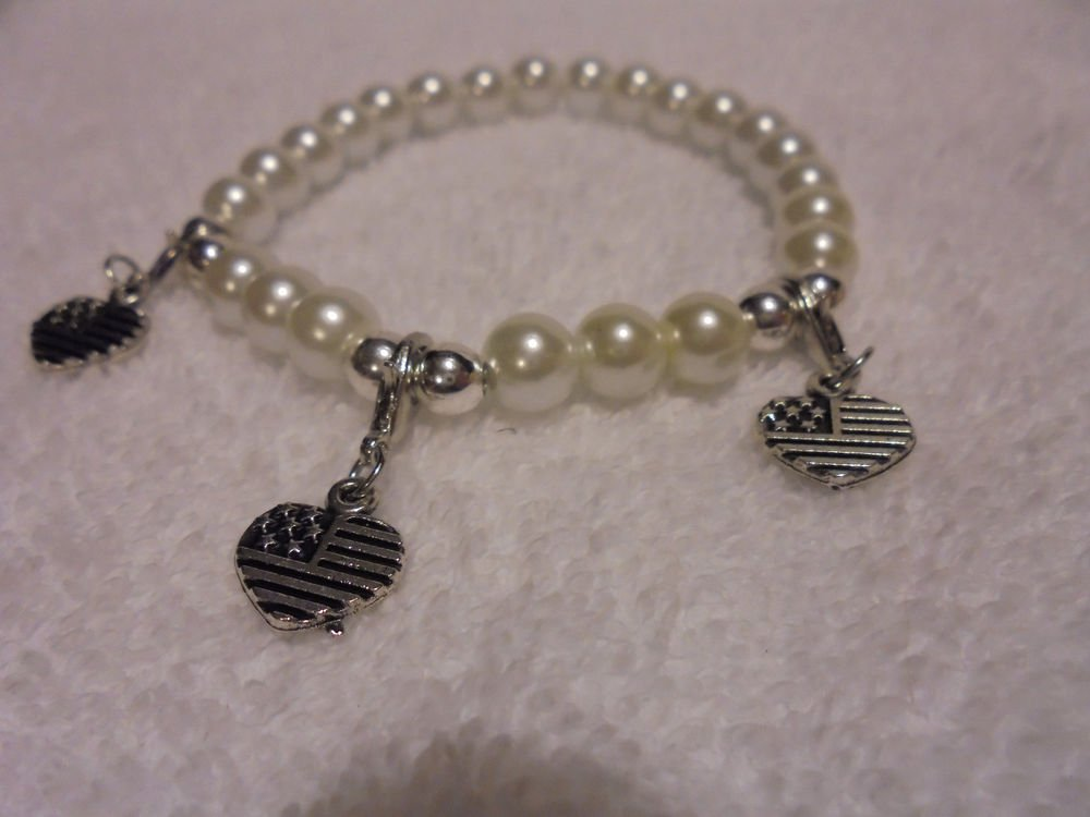 """3 HEART USA"" CHARMS ON A WHITE EXPANDABLE BEADED BRACELET...."