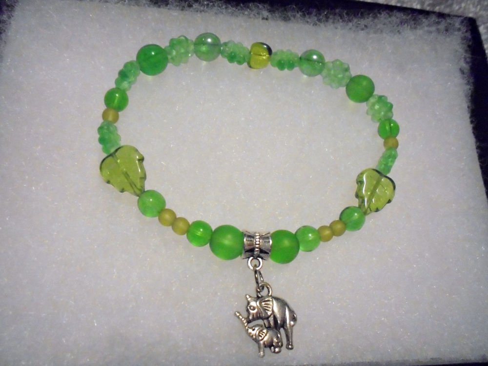 MIXED GREEN BEADED STRETCH WITH SILVER TONE DOUBLE ELEPHANT CHARM.....