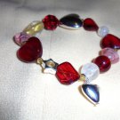 NICE HEART EXPANDABLE BRACELET--RED, PINK & SILVER....SO PRETTY