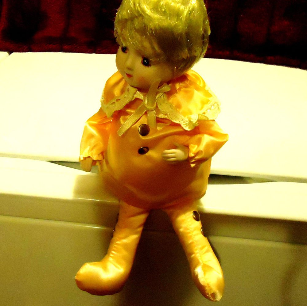 MUSICAL SHELF SITTER.. PORCELAIN DOLL BY SCHMID COLLECTIBLES..ROTATES BODY