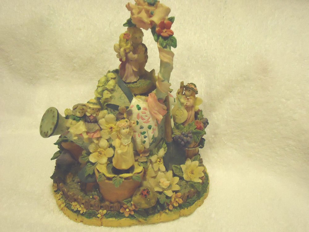 """MUSICAL FLORAL FIGURINE-PLAYS """"WIND BENEATH MY WINGS"""" MOVABLE FIGURES AS IT PLAY"""