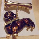 BEAUTIFUL ENAMELED BROWN PUPPY DOG WITH RHINESTONE COLLAR HANGING FROM A BONE