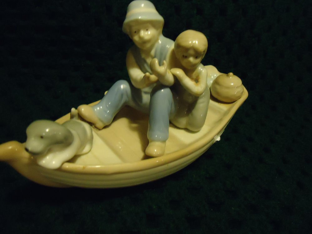 NICE MEICOPORCELAIN MAN FISHING WITH BOY/DOG IN BOAT FIGURINE...NICE QUALITY