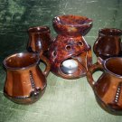 Four cups and candle holders