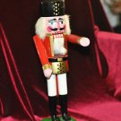 WOODEN NUTCRACKER WITH MOVEABLE ARMS 13 1/2''TALL 5''WIDE,,
