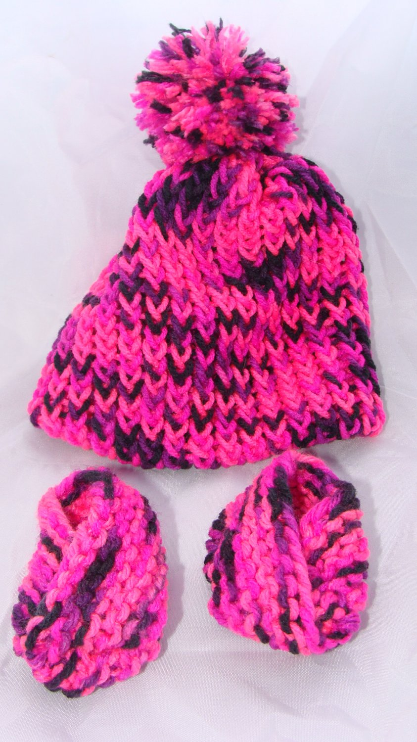 Pink baby booties with pompom hat set