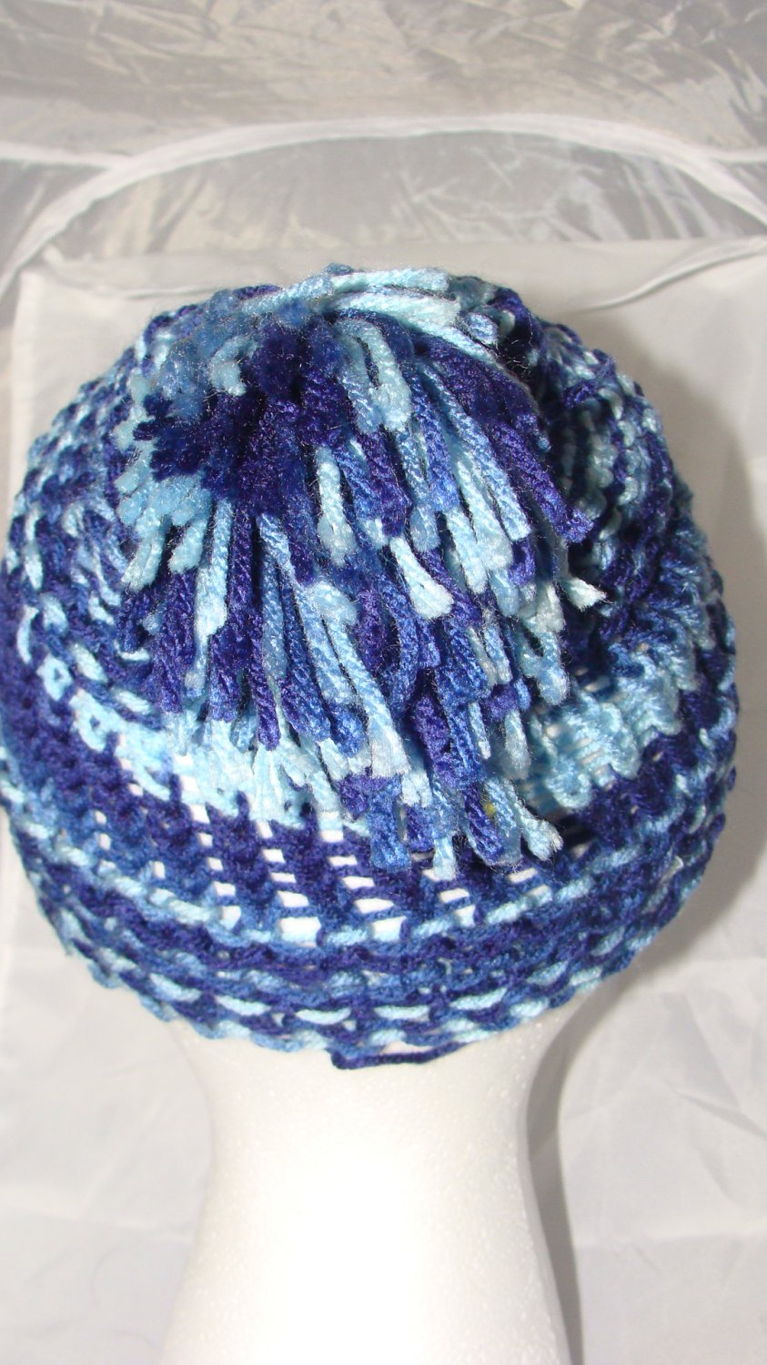 Adult shades of blue hat with pompom