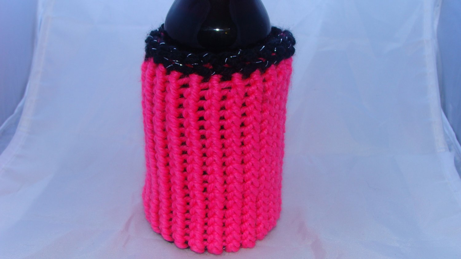 Pink and black reversible bottle/can koozie