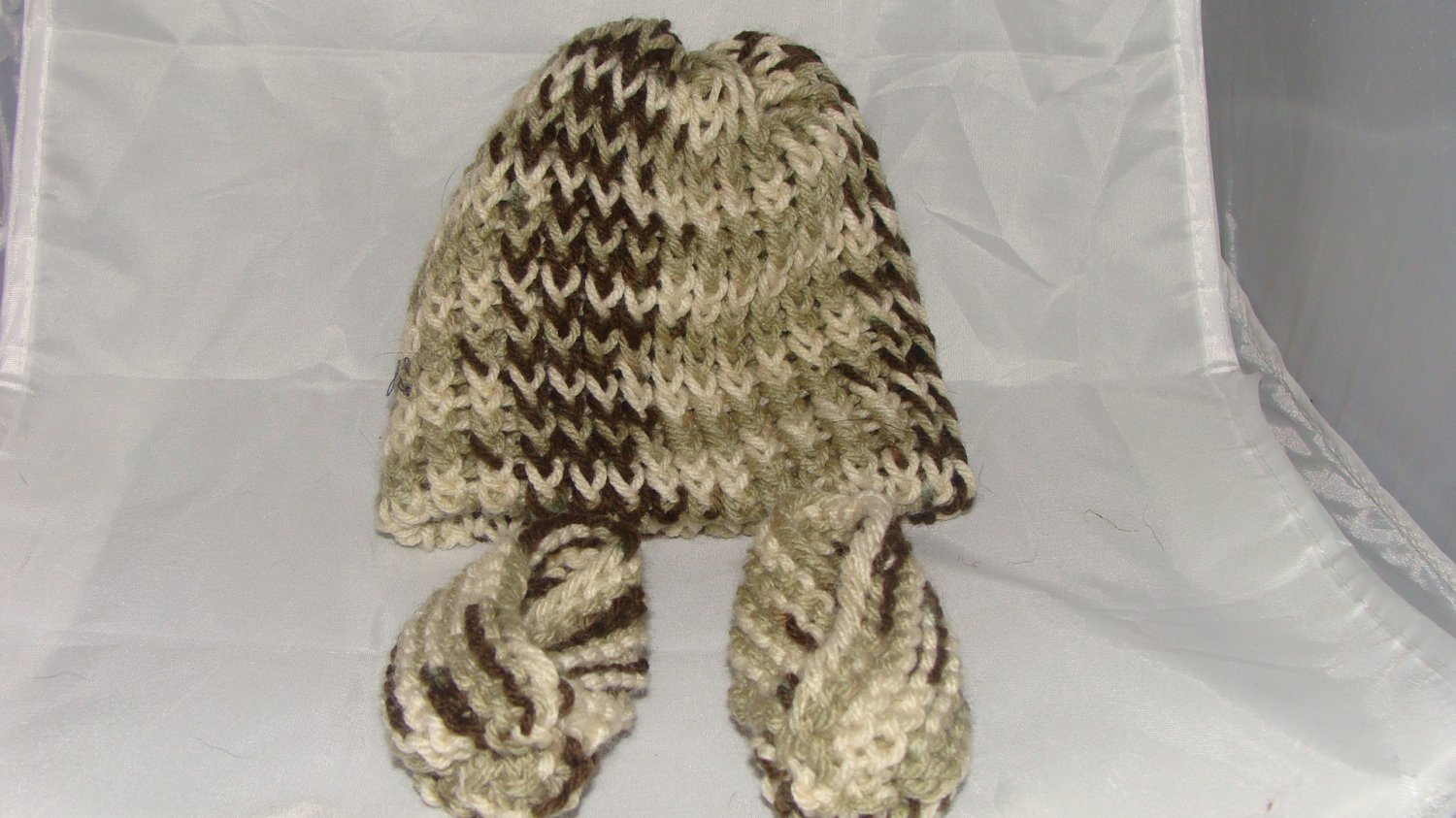 Brown, green and white baby booties and hat set