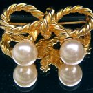 FAUX PEARL BOW BROOCH  (FIG9)
