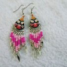 Geometric designs Peruvian style pink, orange and black painted ceramic earrings