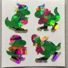 Sandylion Christmas Stickers Dinosaurs on Ice Skates Retro Rare Vintage XPM94