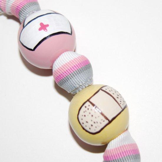 Handpainted Nurse Keychain on Pink Ribbon