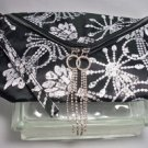"Erikson Beamon Cosmetic bag 10"" X 7"" Black & White with rhinestone zip pull"