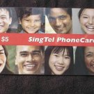 "SINGAPORE phonecard - $5 ""faces of Singapore"" USED"