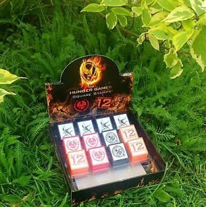 The Hunger Games Stamp Mockingjay Capitol District 12 Official NECA Merchandise