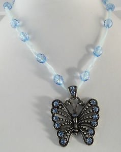 Light Blue Crystal Butterfly Necklace on Beaded Ribbon