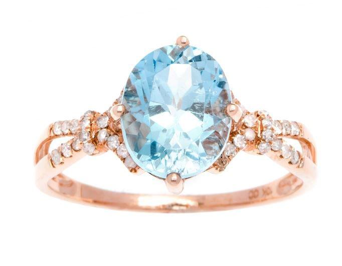 Rose Gold 3.20ct Oval Blue Topaz and Split-Shank Diamond Ring