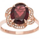 Rose Gold 3.16ct Oval Garnet and Pave Curved Halo Diamond Ring