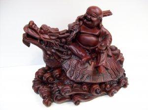 Laughing Buddha on Dragon