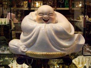 Happy Buddha in white crackle glaze