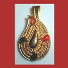 Red Green Orange Black Accents in a Teardrop Shaped Yellow Gold Tone Pendant