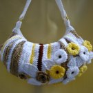 Crochet handbag striped with daisies