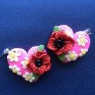 Heart-shaped poppy earrings