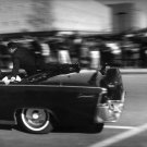 CLINT HILL CLIMBS ATOP PRESIDENT JOHN F. KENNEDY LIMO 1963 - 8X10 PHOTO (AA-219)